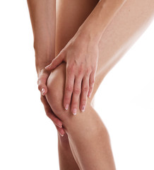 Partial view of woman touching knee feeling pain