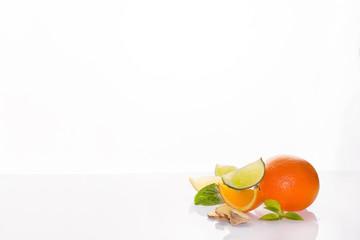 Fresh citrus orange, lemon, lime and mint on a white background
