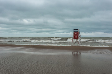 Lonely lifeguard stand on brown beach