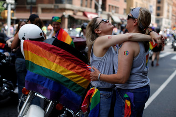 Deborah Spell and her wife Wendy Kennedy embrace before the 2018 New York City Pride Parade in Manhattan, New York
