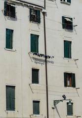 Italian building facade with clothesline