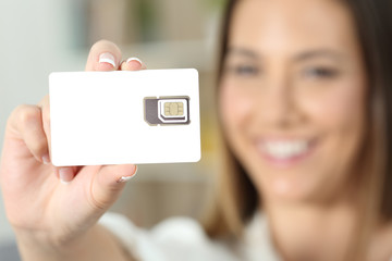 Happy woman hand holding a new telephony sim card
