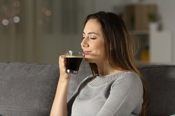 Woman enjoying a cup of coffee in the night