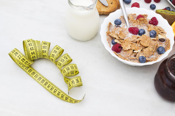 tape measure with healthy breakfast, diet concept