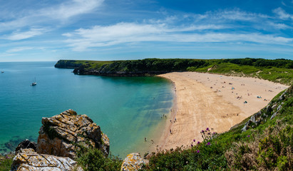 Beautiful sandy beach surrounded by limestone cliffs (Barafundle Bay, South Wales, UK) Wall mural