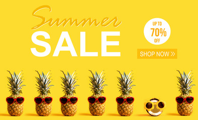 Summer Sale with pineapples and a coconut wearing sunglasses