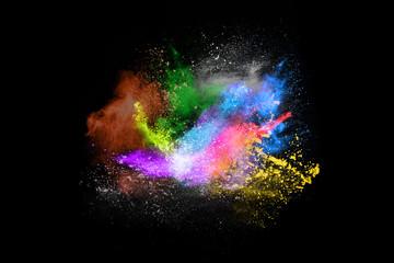 Multicolor powder explosion on black background.