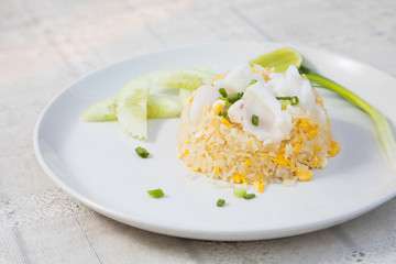 Fried rice with Squid on the wooden table from top view