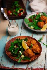Beet falafel with tahina sauce and green salad