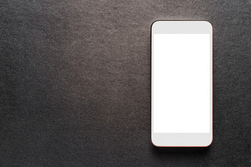 white mobile smartphone on luxury black background, top view.