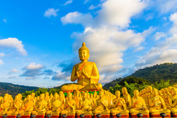the golden big Buddha statue among a lot of small Buddha statues in Makha Bucha Buddhist memorial park at Nakornnayok province.