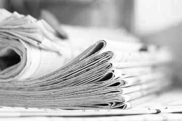 Pile of newspapers. Daily papers with news folded and rolled. Headlines and articles partially shown on pages of tabloid journals, concept for business press