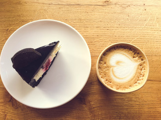 coffee with chocolate cake on the wooden table