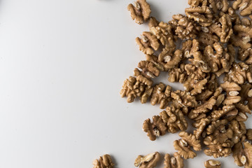 Walnuts on a white table. Close up view. Nuts for health. Selective focus