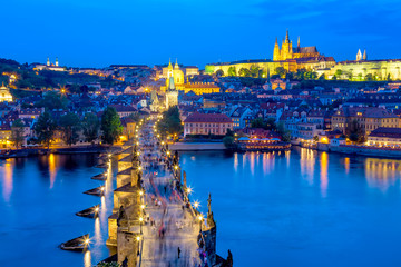 View of Charles Bridge, Prague Castle and Vltava river in Prague, Czech Republic during blue hour