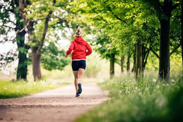 Running woman, enjoying summer day in park - fototapety na wymiar