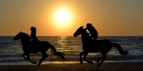 Foto op Aluminium Paardrijden Two horse riders galloping on the beach