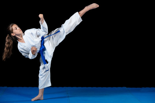 young girl in a white kimono, karate