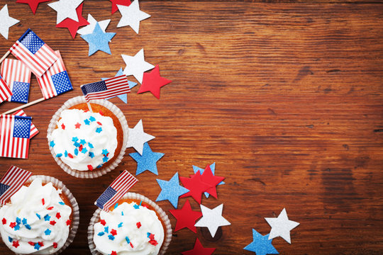 Cupcake decorated with american flag for happy Independence Day 4th july background. Holidays table top view.