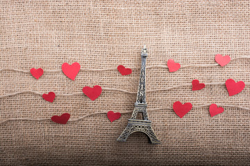 Love concept with Eiffel tower and heart shaped icons