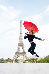 Woman jump with fashion umbrella. Happy woman travel in paris, france. Parisian isolated on white background. Girl with beauty look at eiffel tower. Travelling and wanderlust. Enjoy summer vacation