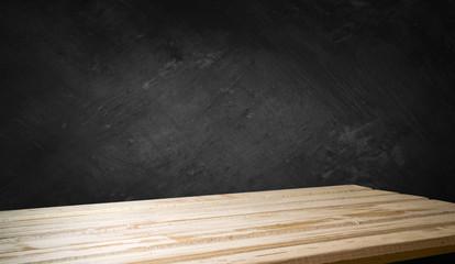 Wooden deck table on grey grunge background