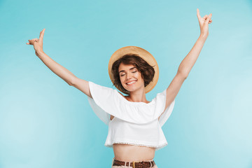 Portrait of a cheerful young woman in summer hat Wall mural