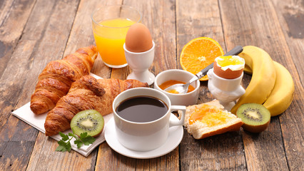 breakfast with coffee, egg, croissant and fruit
