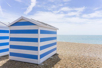 Blue and white striped beach huts at the seaside