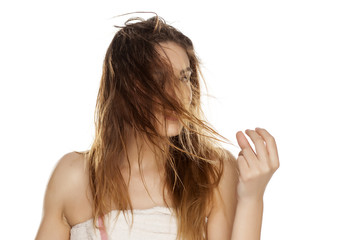 young woman with wet messy hair on a white background