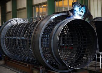 A worker walds at the machine-building company Zemmler Siebanlagen in Massen