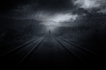 mysterious fantasy scene with ghostly shadow on railroad tracks