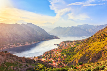 Panoramic view from above on the old city Kotor, bay in Adriatic sea and mountains, Montenegro, sunset time, gorgeous nature landscape