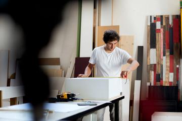 Carpenter takes measures for furniture