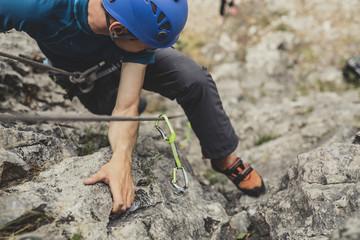 Foto op Plexiglas Alpinisme Male Alpinist Climbing a Rock