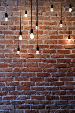 Old red brick wall with bulb lights lamp