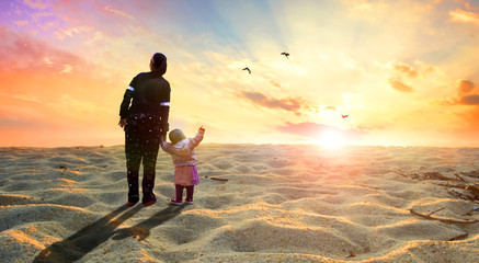 The concept of hope: mother and child in the desert