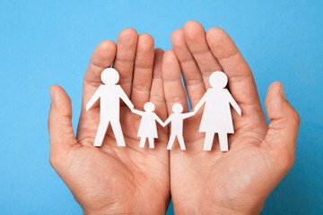 Family insurance. Man holds family, father, mother, son and daughter