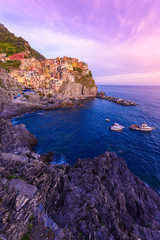 Fototapete - Manarola - Village of Cinque Terre National Park at Coast of Italy. Beautiful colors at sunset. Province of La Spezia, Liguria, in the north of Italy - Travel destination and attractions in Europe.