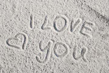 Handwriting text I love You on salt. Symbol of love. Valentine day card. Romantic background.