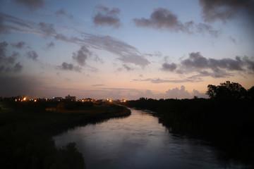 The Rio Grande flows under the Brownsville-Matamoros International Bridge at first light near Brownsville