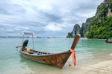 Wooden long tail boat anchored on phi phi island