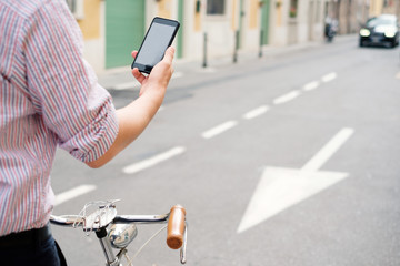 Using mobile phone while driving his bike