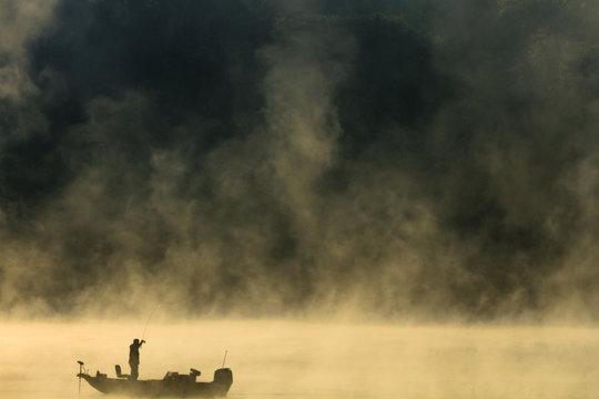 Bass Fisherman In Fog