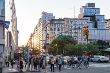 Crowds of people crossing Broadway near Union Square Park in Manhattan New York City NYC