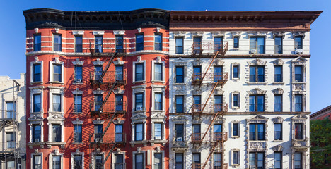 Fototapete - Panoramic view of old brick building against blue sky background in the East Village of Manhattan in New York City