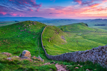 Twilight at Hadrian's Wall Caw Gap / Hadrian's Wall is a World Heritage Site in the beautiful Northumberland National Park. Popular with walkers along the Hadrian's Wall Path and Pennine Way