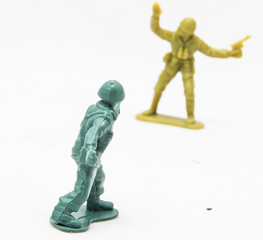 Two Plastic toy soldiers on white background