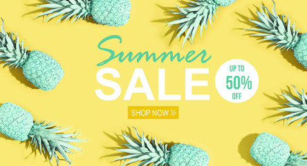 Summer sale with painted pineapples on a yellow background