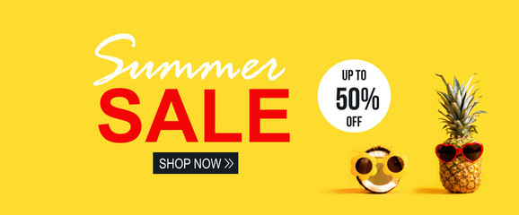 Summer Sale with pineapple and coconut wearing sunglasses